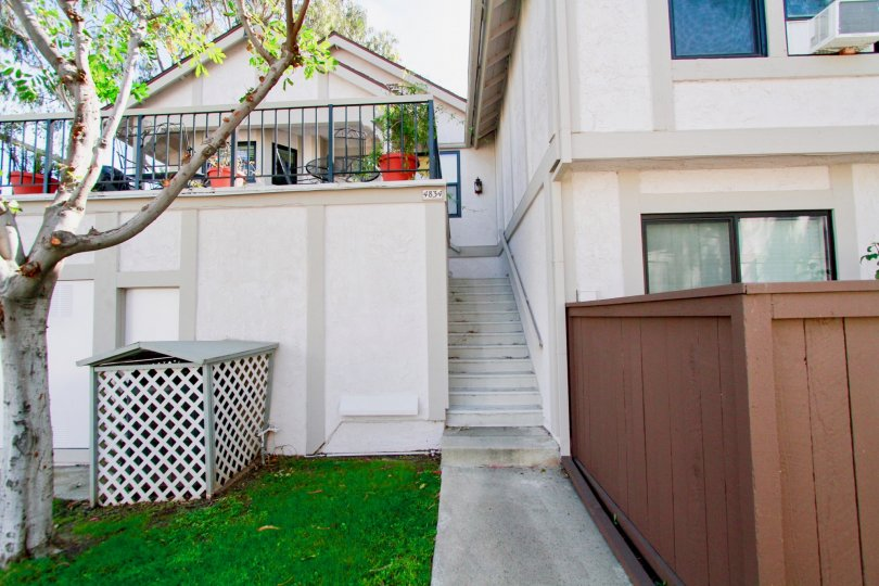 Enjoy the beautiful porch of this home located in the Cypress, California community Influential Townhomes