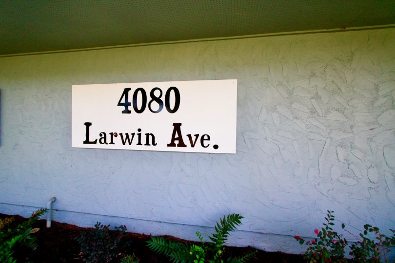 Tanglewood West Cypress California plain long wall with large sign board at front