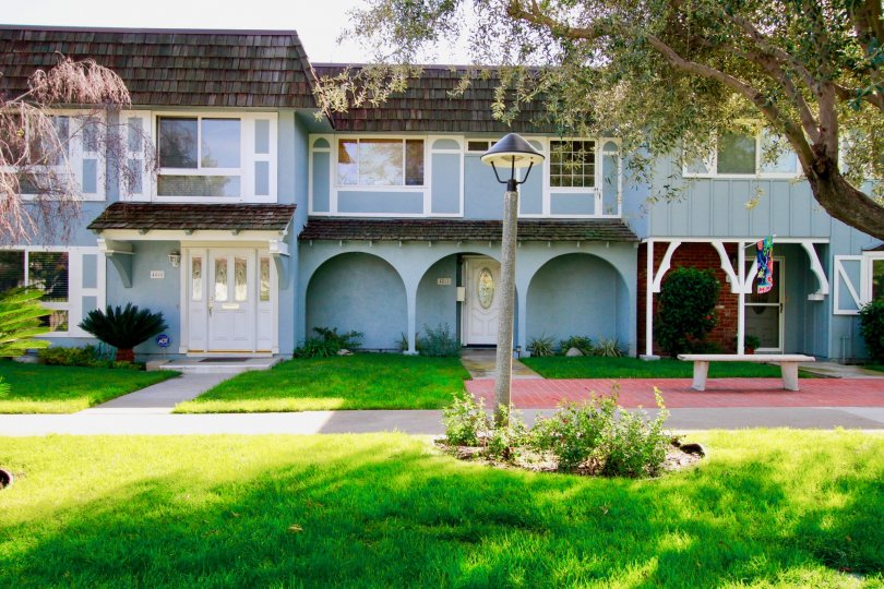 Blue homes with a light fixture in Cypress, California.