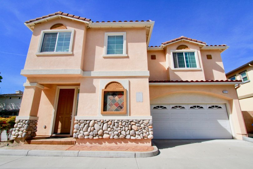 Sunny picture of a home in The Cove community in Cypress, California.