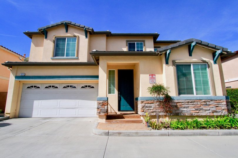 A sunny view of a home in The Cove community located in Cypress, California