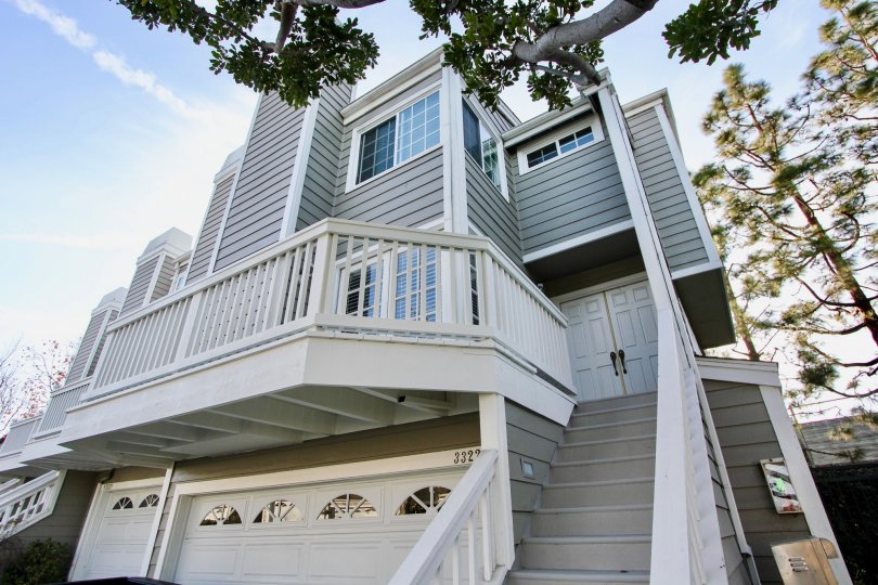Side view with trees and staircase of Marinita Townhomes, Dana Point, CA