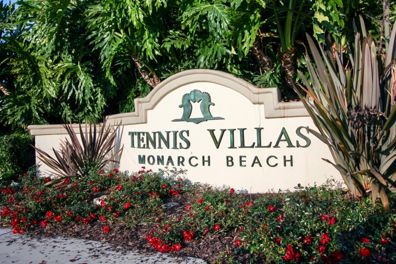 A noticeable community sign sits at the entrance of Tennis Villas in Dana Point California