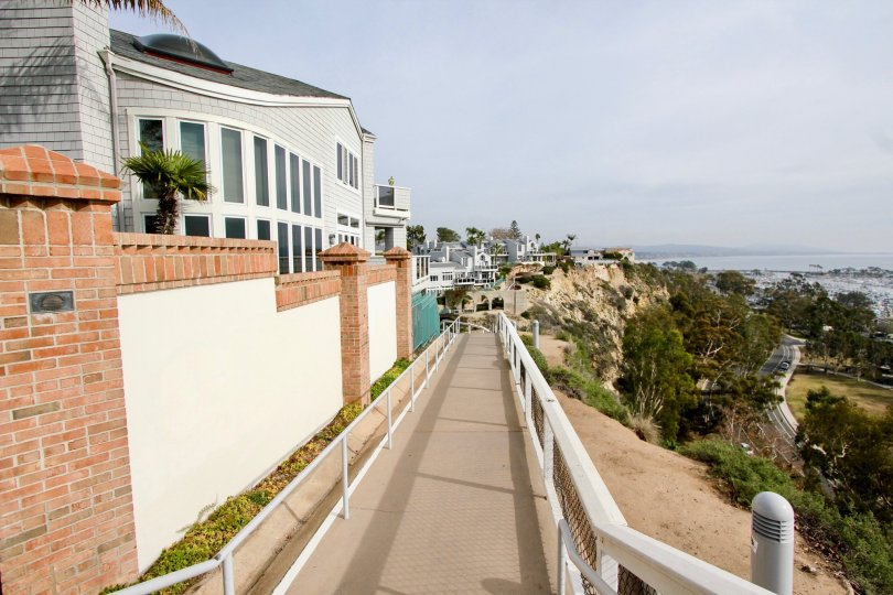 A gorgeous building on a hillside that overlooks a valley at The Admiralty in Dana Point CA