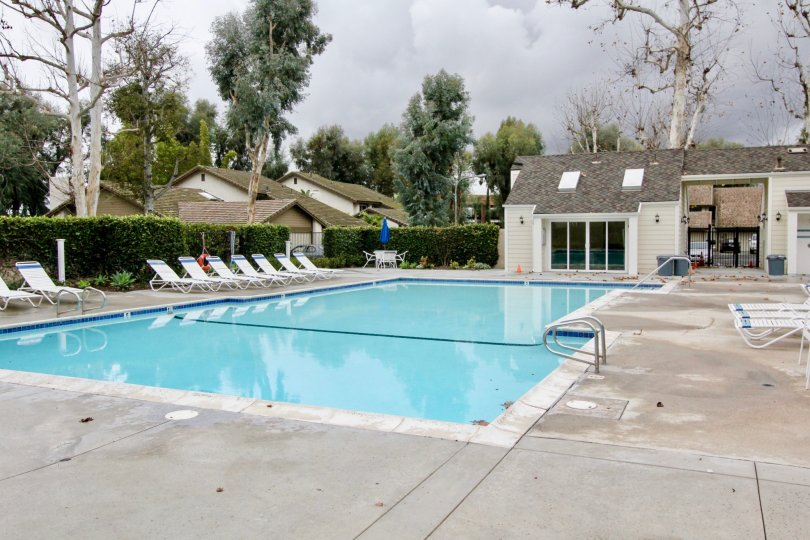 A refreshing pool with lounge chairs in the Emerald Glen community.