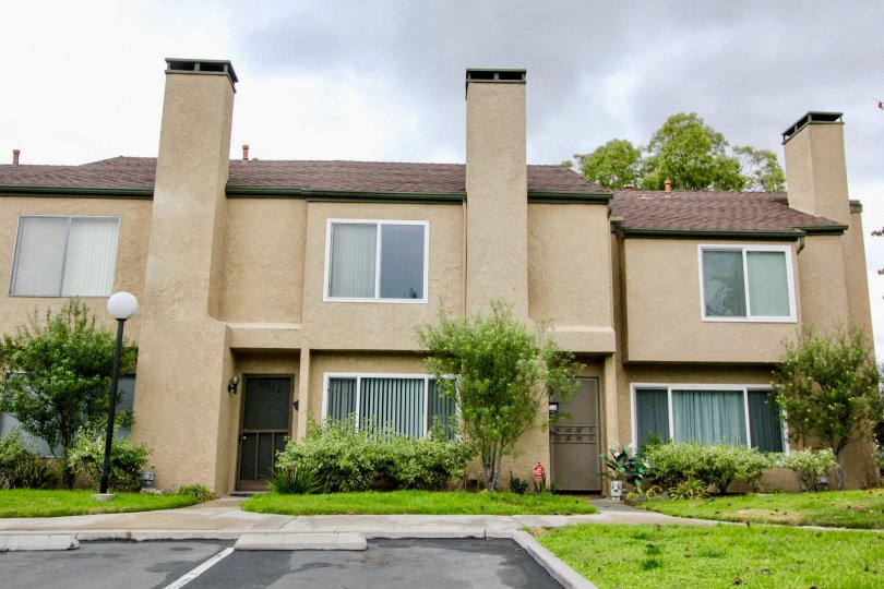 Multi level housing with large three panel windows in Fountain park community.