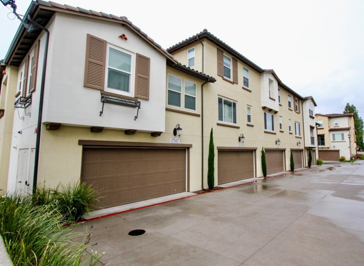 Tan residential houses that have brown garages in Solana Walk community.