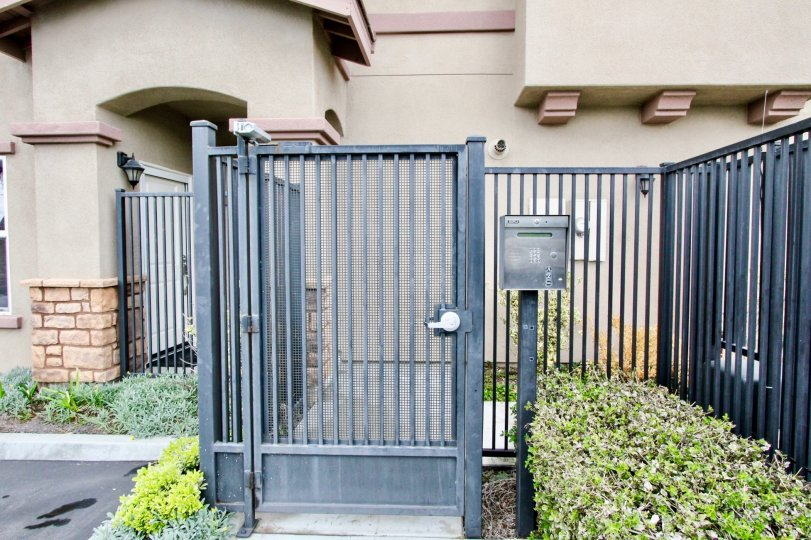 Telephone booth is placed between the gate and cutting bushes of villa in summerstone villas