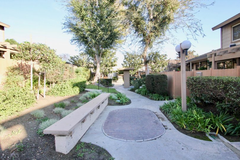 walkway through Amberwood community with bench and streetlight in Fullerton, California