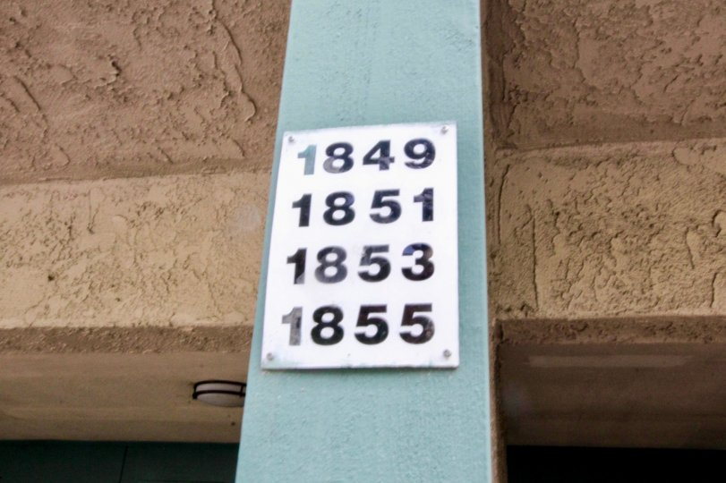 Brea Country Fullerton California with brown shrinked roofing model ceiling and four house numbers at front pillar