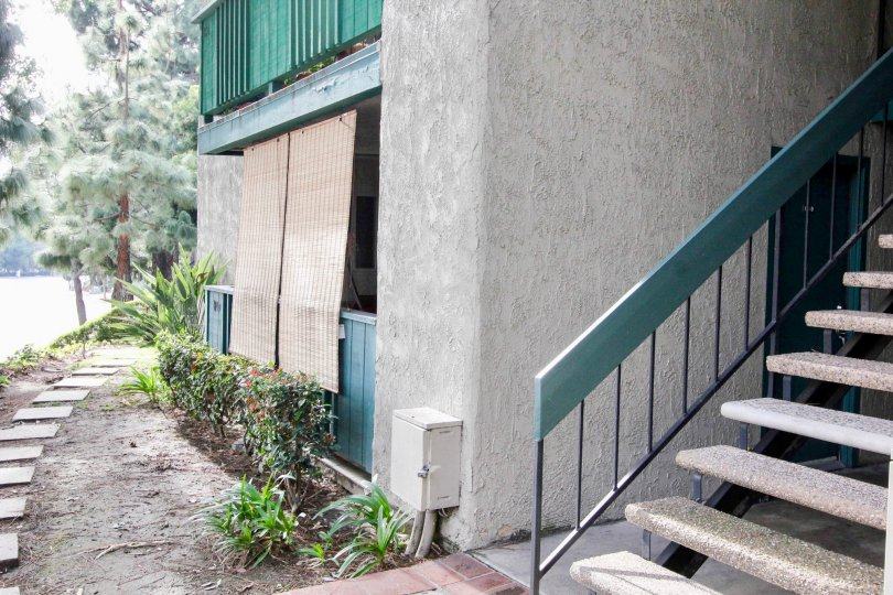 A building in Brea Country with a stair case and a balconies.