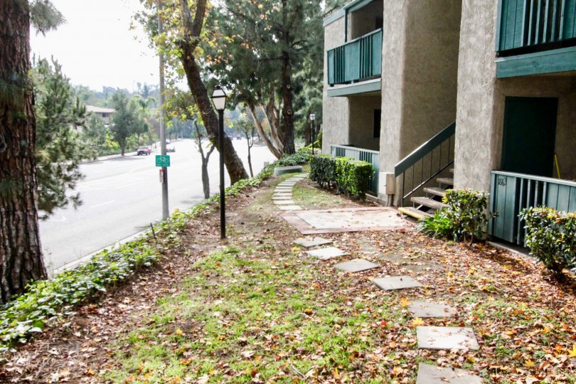 This is a picture of apartment complex next to street in Fullerton, CA