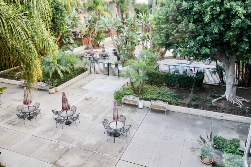 Aerial view of Club Acacia courtyard with chairs and tables.