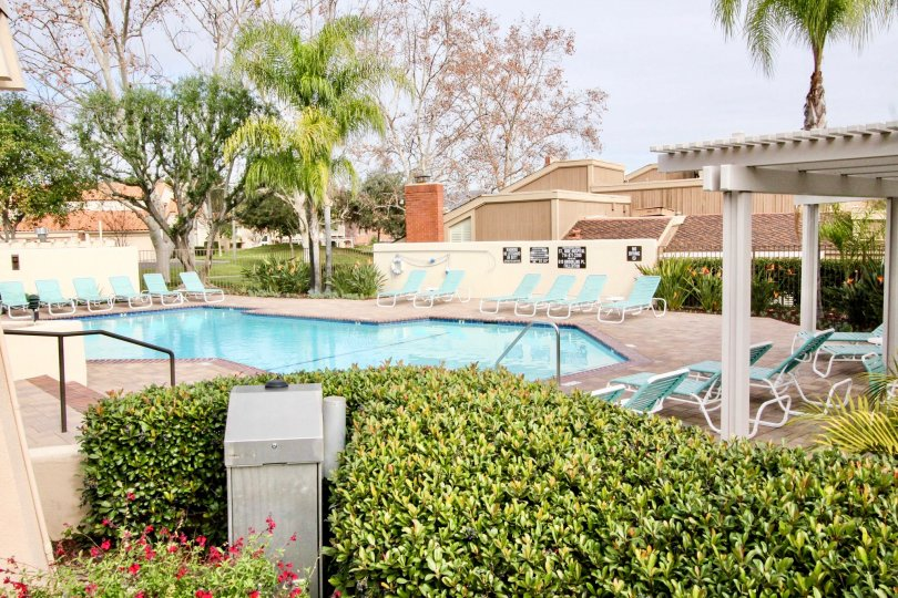 A pool area at Fairway Village in Fullerton, California with chairs to relax