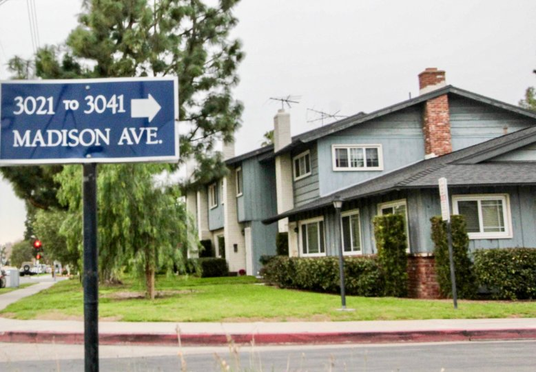 Foothill Village Fullerton California nice colored apartment colony with name board at front gate