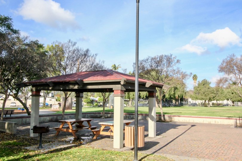 The park in Fullerton fountains has lawn with picnic tables and chairs