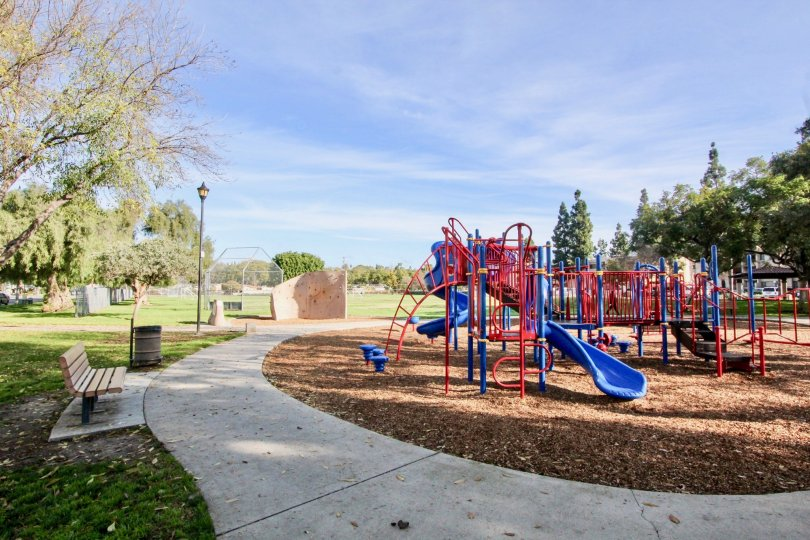 A clear day in the Fullerton Fountains with children's playground and picnic tables.
