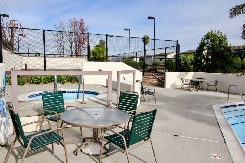 Hot spa and pool with patio tables and chairs at Greenview Terrace.