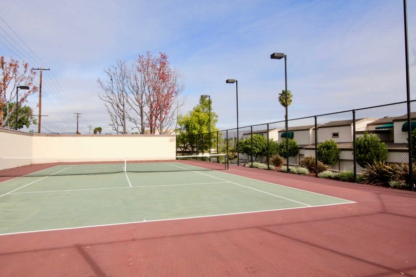 A cloudy day on the tennis courts behind Greenview Terrace in Fullerton, California