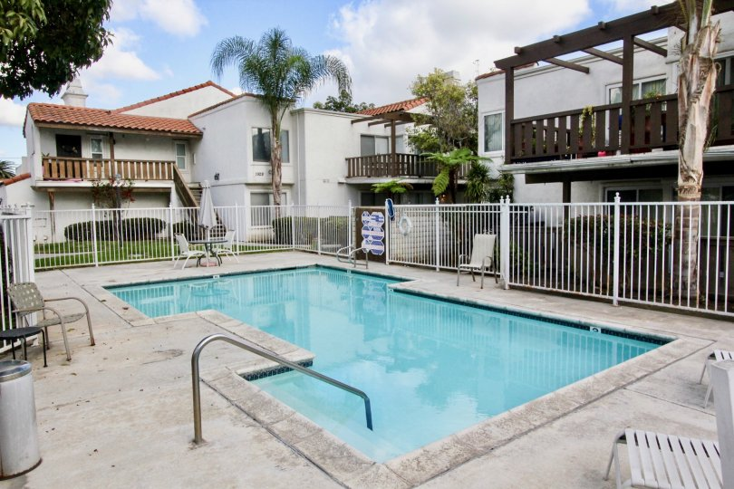A relaxing looking pool surrounded by residential housing in heritage Fullerton community.