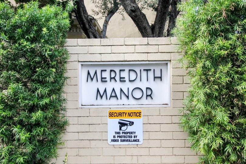 In The wall of Meredith Manor has noticed a security warning that video camera should be there for protection