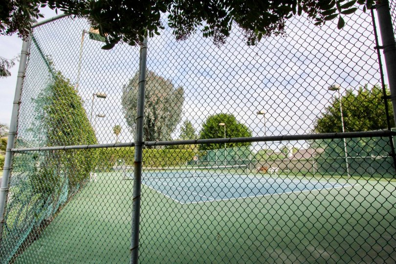 Fenced in tennis courts and light post Stone Pine Estates Fullerton CA