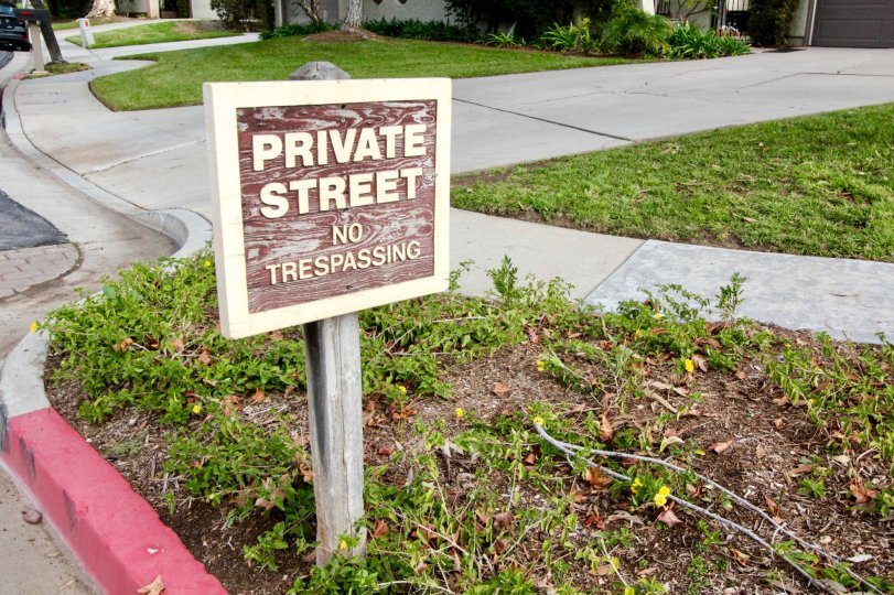 A no trespassing sign in the Stone Place community with sidewalks and driveways.