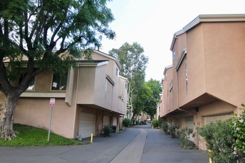 A street in Water Gardens separating apartment buildings with garages.