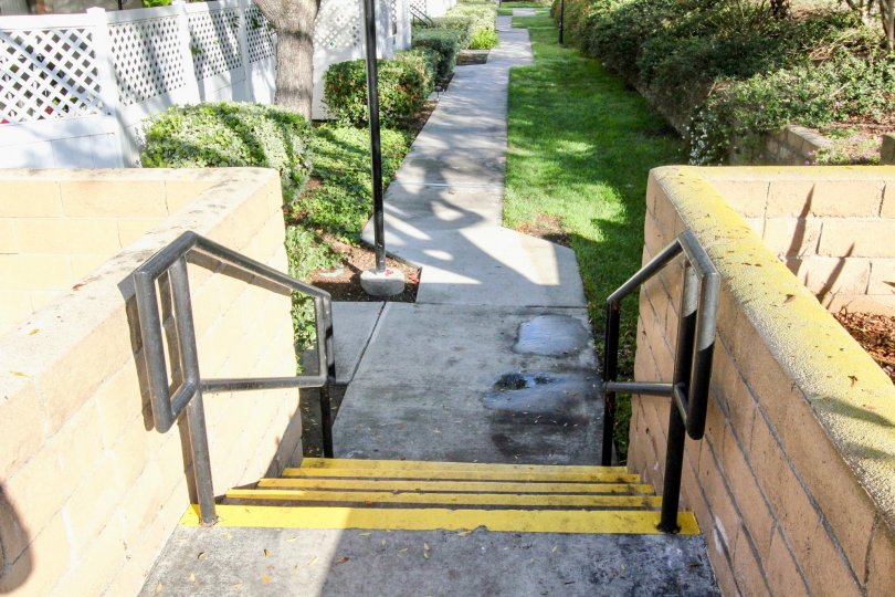 Westside Fullerton California park like area with broad steps painted in yellow and short walls