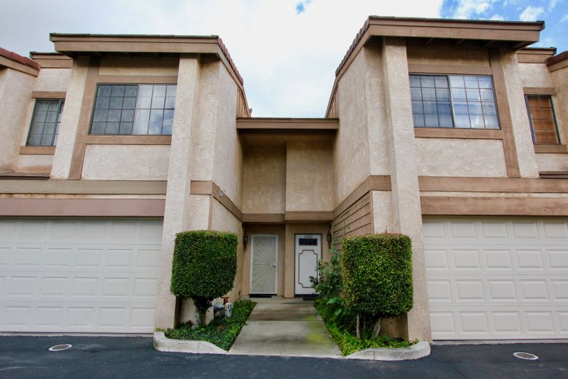Two large condominiums with a single sidewalk leading to their entrances at Adelle Terrace in Garden Grove CA