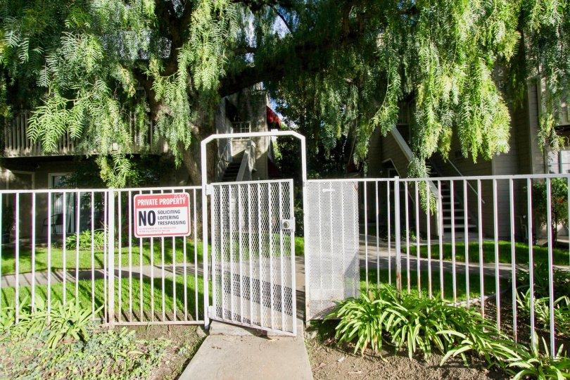 compound gate have private property board near trees and plants around in Cobblestone Creek
