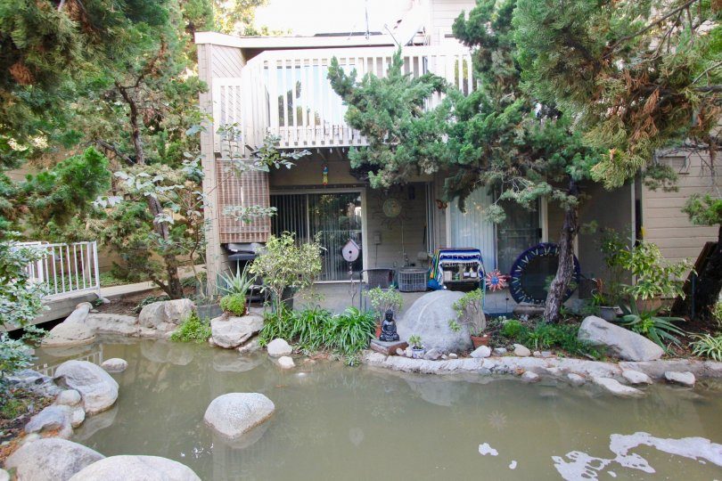 THE FLAT IN THE COBBLESTONE CREEK WITH THE STONES, WATER, PLANTS, TREES