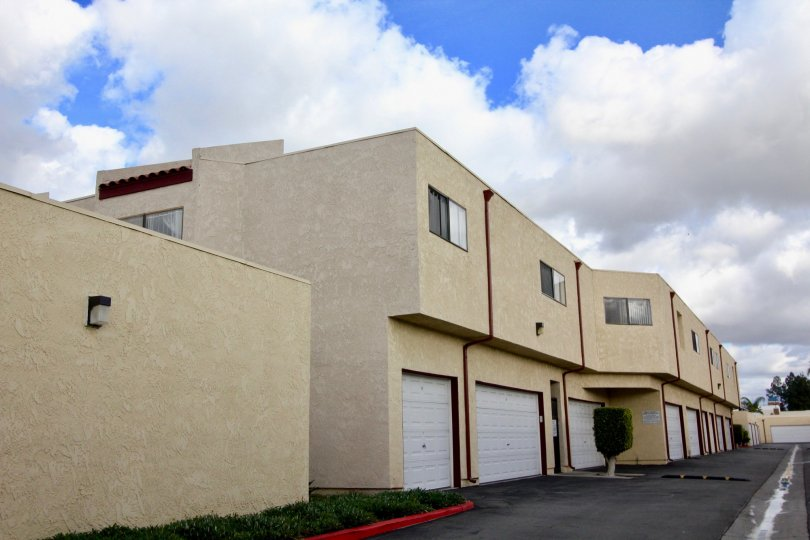 A row of apartments with included garages on a cloudy day in the Garden Creek neighborhood of Garden Grove, California.