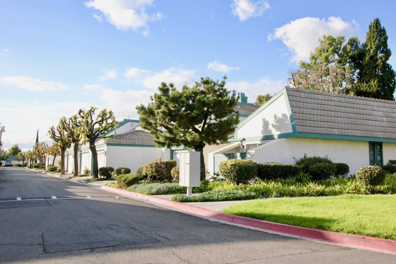 Street view of the Garden Greens Community on a sunny day in Garden Grove, California.