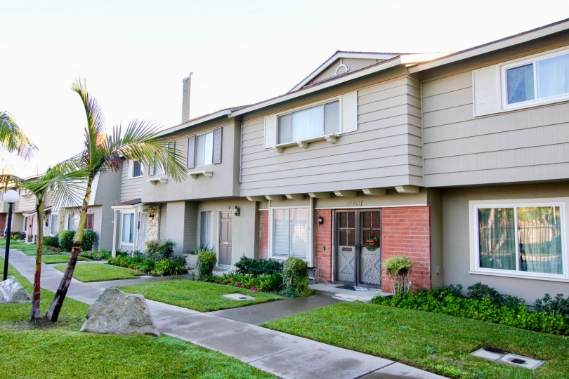 Grey two story town homes with sidewalk in Garden Grove, CA