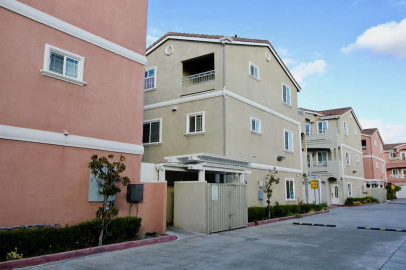 A large residential complex inside the Golden village community with a big drive way