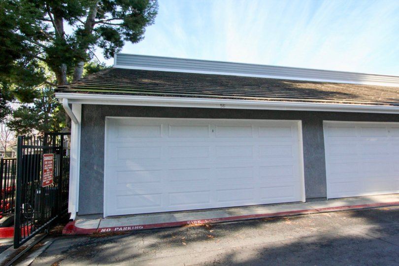 Large Garage Doors in building with No Parking on Curb at Greenbrier Terraces in Garden Grove, CA