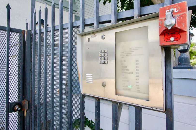 A security gate in Hewitt Place Townhomes with a keypad and intercom.