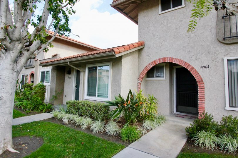 A lovely home with rounded entranceway and garden in La Jolla Plaza, Garden Grove, CA