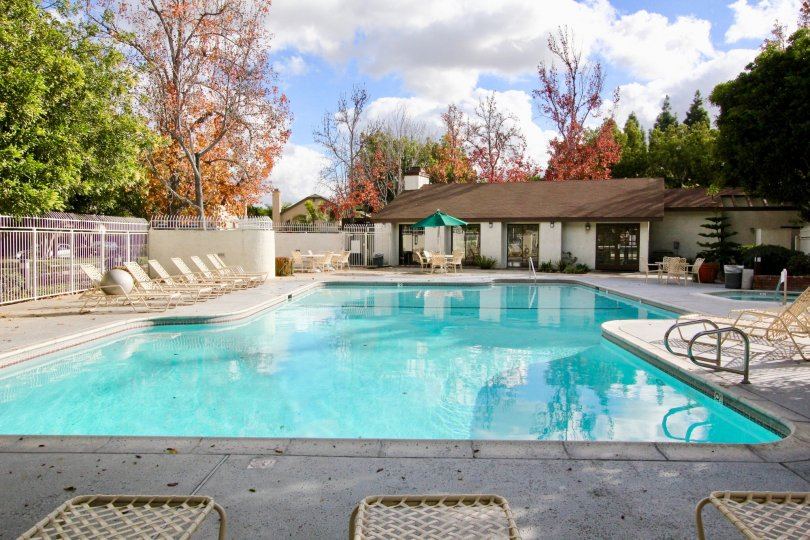 A large pool and lounge area on a sunny day, locatedd in Meadow Brook Vllage, in Garden Grove, California.