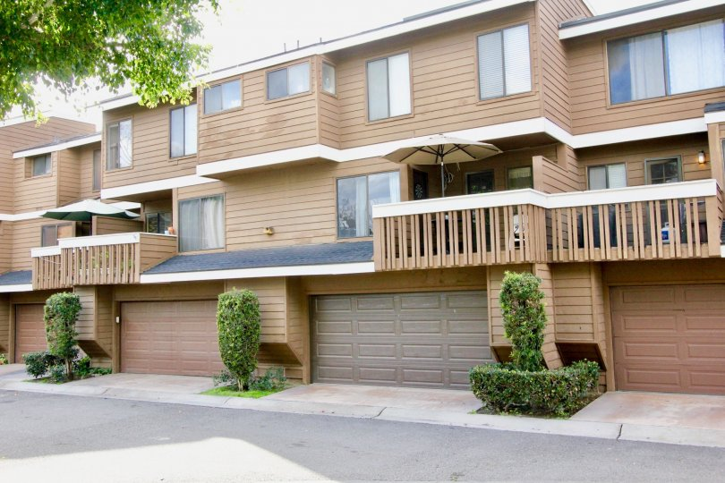 A large house with a multiple garage doors inside Meadow brook village community