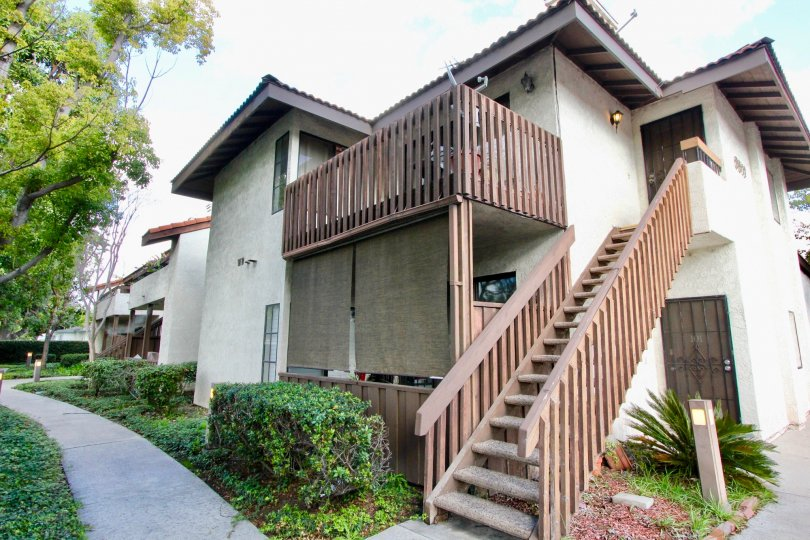 Home with staircase and balcony at Meadow Brook Village in Garden Grove CA