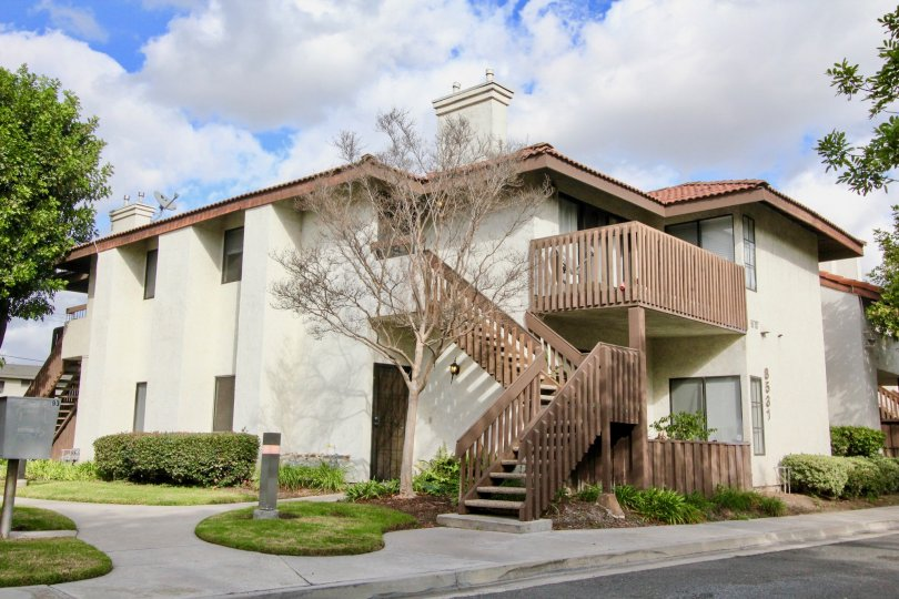House at the Meadow Brook Village in Garden Grove with little trees and road