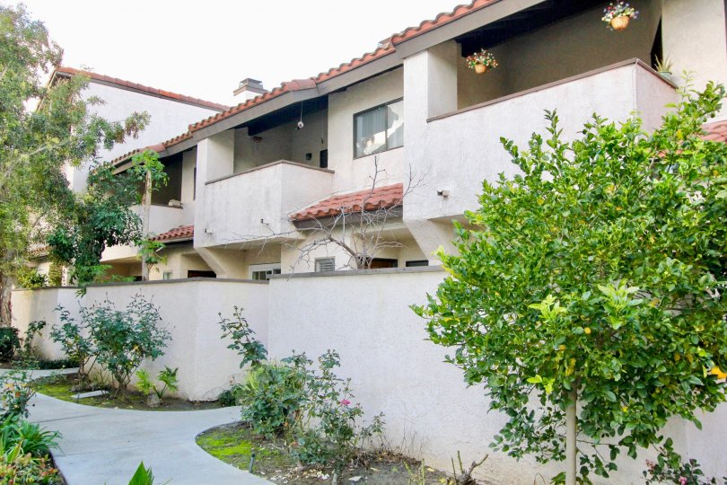 The Peppertree Townhomes provide privacy with walls and trees in Garden Grove California