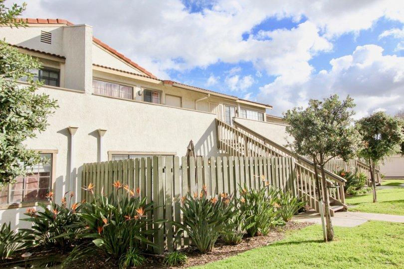 A two story residence with a fence-lined garden at Spring Garden Villas, in Garden Grove, California.