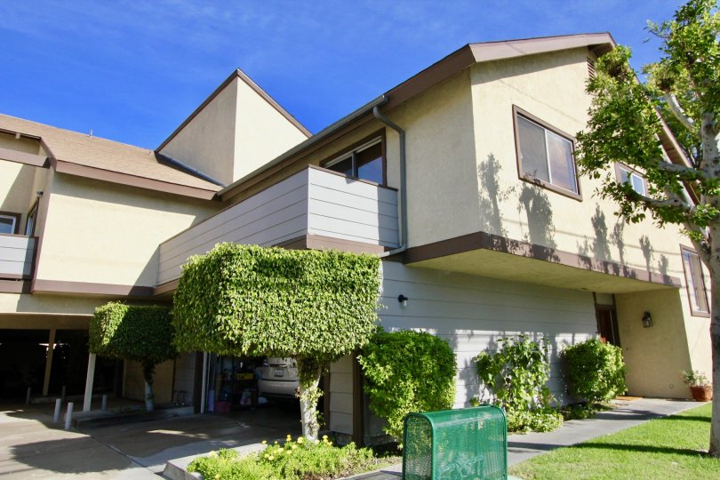 A condo with overhang and balcony on a sunny day in Stanford Plaza in Garden Grove, California.