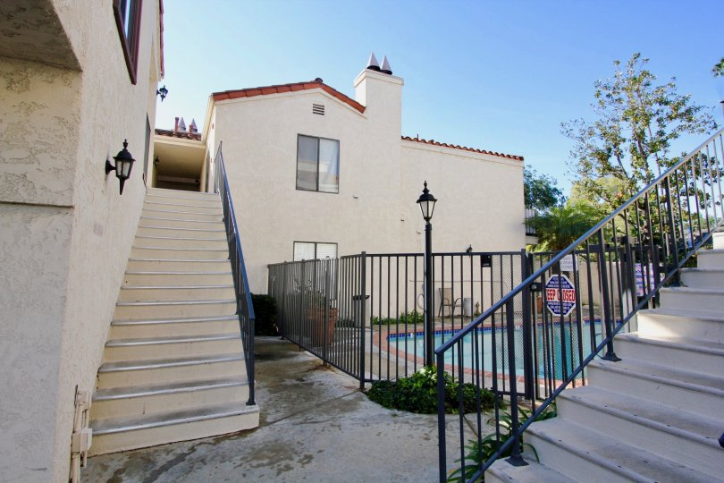A stairway leading up into a condominium near a swimming pool inside Villa Grande in Garden Grove California