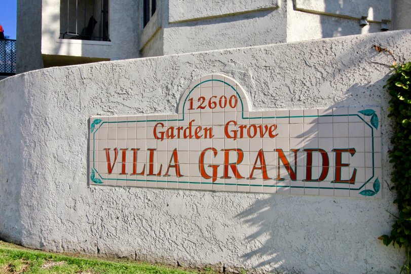 A stone signage with tiled wordings in the Villa Grande community.