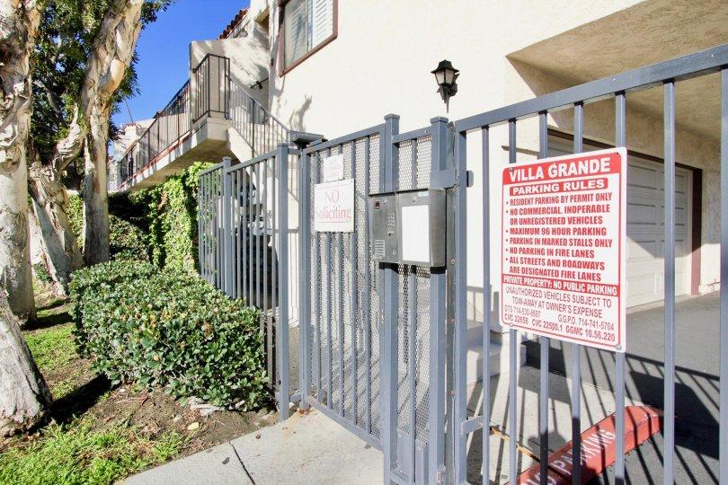 A large board describing parking rules inside villa grande community