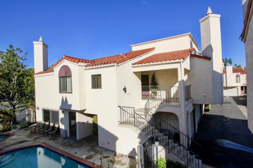 A multistory Spanish-style home with an included pool and set of garages located in the Villa Grande area of Garden Grove, California.